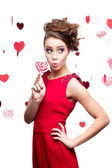 Young cheerful woman holding lollipop — Stock Photo