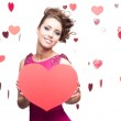 Brunette woman holding big red paper heart — Stock Photo