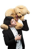 Businessman with big soft toy on shoulders — Stock Photo
