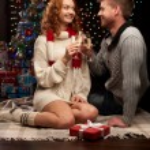 Young couple celebrating christmas — Stock Photo