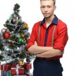 Young vintage man standing near christmas tree — Stock Photo
