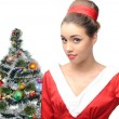Sensual retro girl near christmas tree — Stock Photo