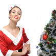 Cheerful retro girl standing near christmas tree — Stock Photo