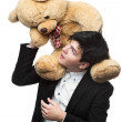 Stock Photo: Businessmwith big soft toy on shoulders