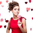 Stock Photo: Brunette woman holding lollipop