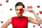 Brunette woman holding lollipop — Stock Photo