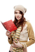 Happy woman reading red postcard — Foto Stock
