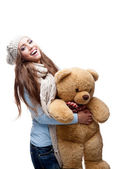 Casual beautiful girl holdingsoft toy — Stock Photo