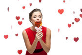 Caucasian woman in red dress holding lollipop — Stock Photo