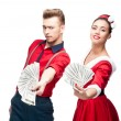 Young retro couple holding money — Stock Photo