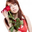 Girl holding red roses — Stock Photo