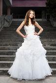 Beautiful young woman in wedding dress — Stock Photo