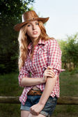 Red haired cowgirl — Stockfoto