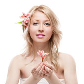 Blond girl with flower — Stock Photo