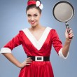 Stock Photo: Cheerful retro housewife