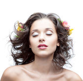 Young woman with flower in hair — Stock Photo