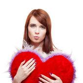 Girl holding fur red heart — Stock Photo