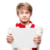 Young funny man holding sign — Stock Photo