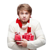 Young funny man holding christmas gifts — Stock Photo