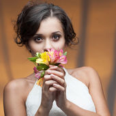 Sensual young woman with flower — Stock Photo
