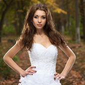 Beautiful young woman in wedding dress — Stock Photo