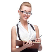 Businesswoman holding diary — Stock Photo