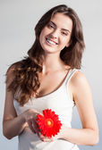 Beautiful girl with red flower — Stock Photo