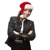 Young cheerful businesswoman in santa hat standing isolated on w — Stock Photo