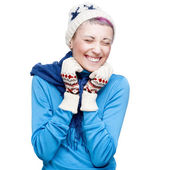Young cheerful girl in winter clothing on white — Stock Photo