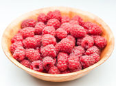 Red raspberry in plate — Stock Photo