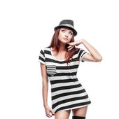 Thoughtfull stylish girl in black and white dress — Stock Photo