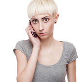 Casual blond girl holding cell phone — Photo