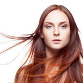 Red woman with blowing hair — Stockfoto