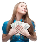 Businesswoman holding money — Stock Photo