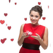 Caucasian woman in red dress holding gift — Stockfoto