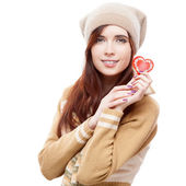 Cheerful woman holding red paper heart — Stock Photo