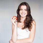 Girl holding red apple — Stock Photo