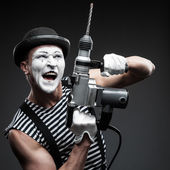 Mime with hammer drill — Stock Photo