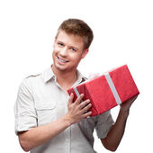 Young casual man hoding christmas gift — Stock Photo