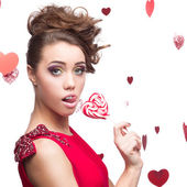 Brunette woman holding lollipop — Stock Photo