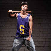 Hip-hop style man holding baseball bat and chain — Stock Photo