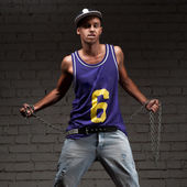 Hip-hop style man holding chain — Stockfoto