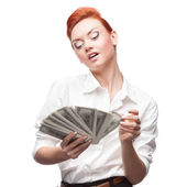 Admiring business woman counting money — Stock Photo
