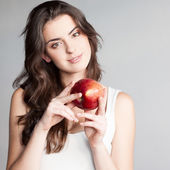 Girl holding red apple — Stock Photo