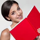 Casual girl holding red book — Stock Photo