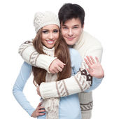 Young smiling couple in winter clothing embracing — Stock Photo