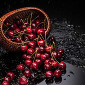 Cherry falling from basket — Stock Photo
