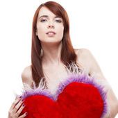 Girl holding fur red heart — Stock Photo