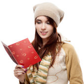 Happy woman reading red postcard — Stock Photo