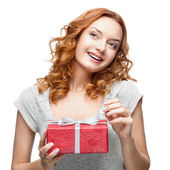 Happy woman holding gift — Stock Photo